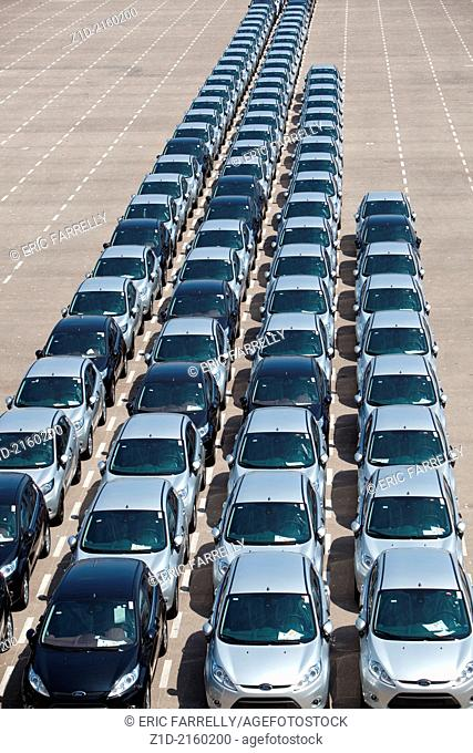 New cars being unloaded and parked on quayside of the port of Valencia Spain
