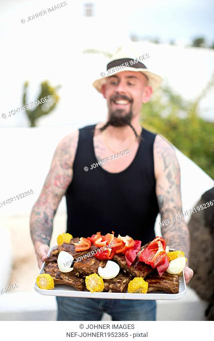 Man on holiday with a tray of food