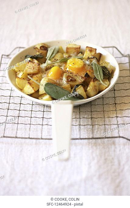 Fried potatoes with egg and sage