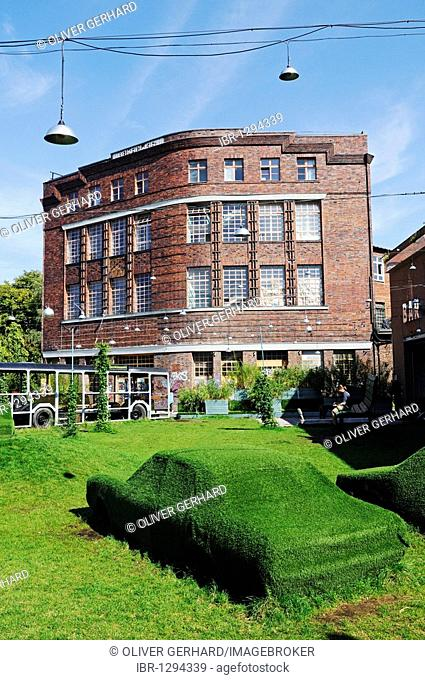 Art in front of the Atelierhaus building on the Flutgraben canal, last frontier post of the former GDR, Berlin-Treptow, Germany, Europe