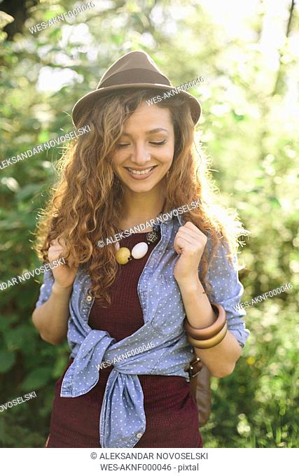 Portrait of smiling young woman hiking