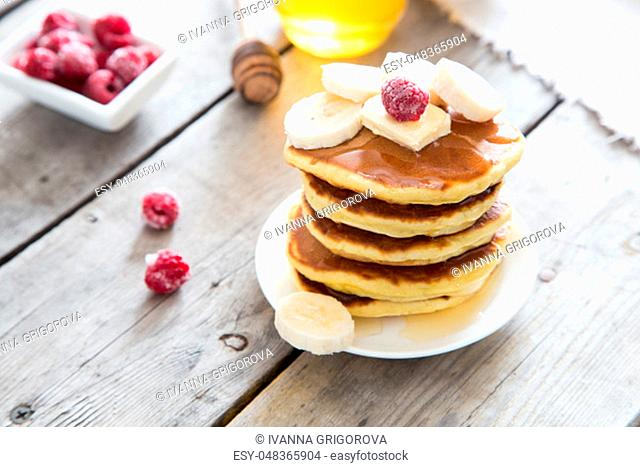 Sweet Homemade Stack of Pancakes with Butter and Honey for Breakfast