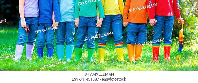 Kids in rain boots. Group of kindergarten children in colorful rubber boots and autumn jackets. Footwear for rainy fall. Foot wear for child and baby