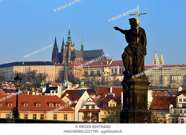 Czech Republic, Prague, historical centre listed as World Heritage by UNESCO, statue of John the Baptist on Charles Bridge (Karluv Most) with the royal castle...