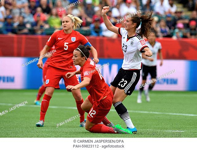 Germany's Sara Däbritz (R) and Steph Houghton (L) and Lucy Bronze from England vie for the ball during the FIFA Women's World Cup 2015 third place soccer match...