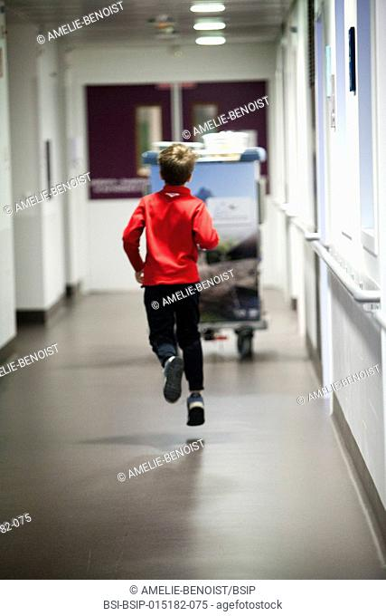 Reportage in the pediatric unit in a hospital in Haute-Savoie, France. A young patient goes to the canteen