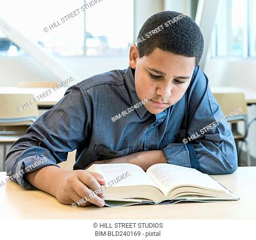 Teenage boy reading book