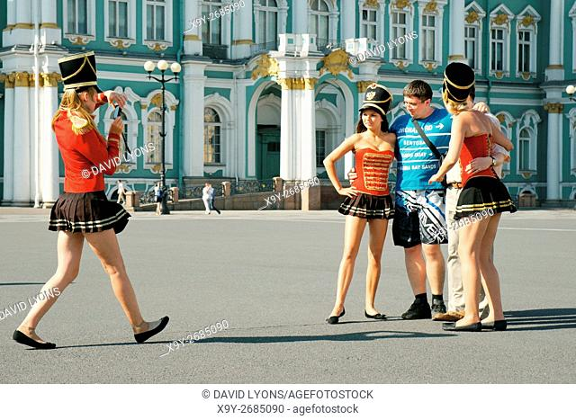 Saint Petersburg Russia. Enterprising young women pose as Palace Guards for tourist photographs in front of the Winter Palace