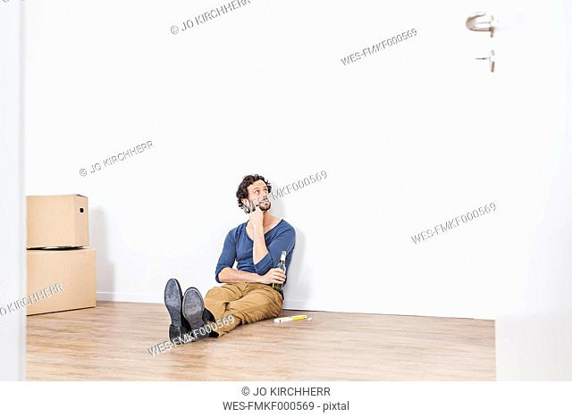 Man sitting on floor and looking away