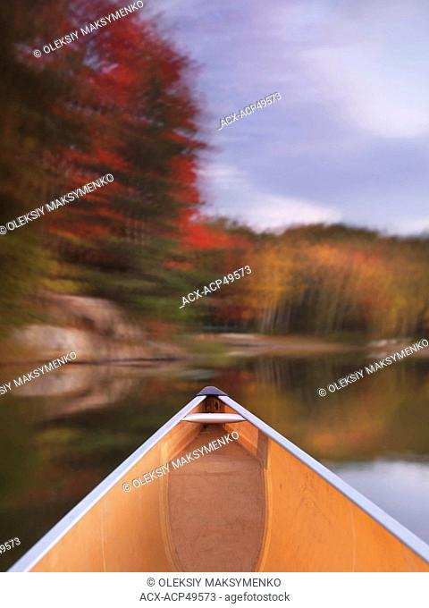 Canoeing on lake George in beautiful fall nature scenery. Killarney Provincial Park, Ontario, Canada