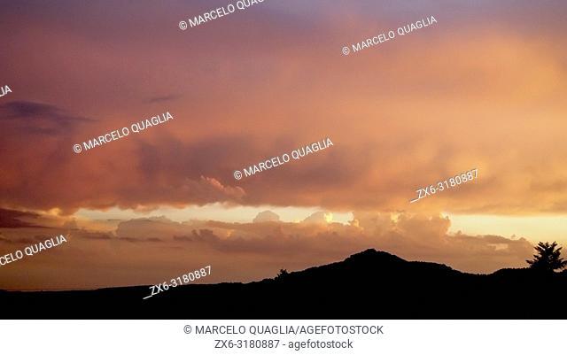 Colorfully intense cloudy sunset. Lluçanès region, Barcelona province, Catalonia, Spain