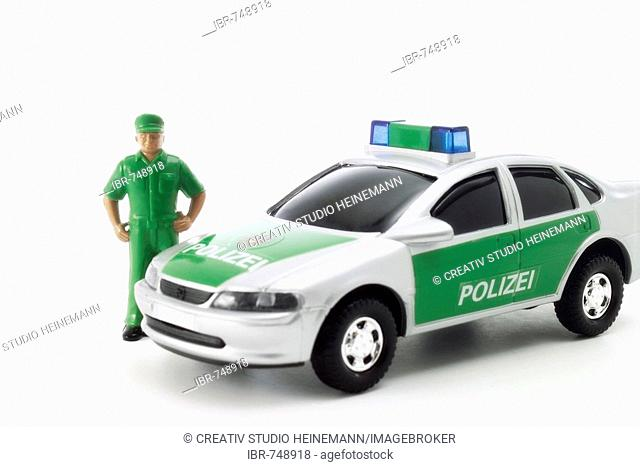 Toy police car and police officer