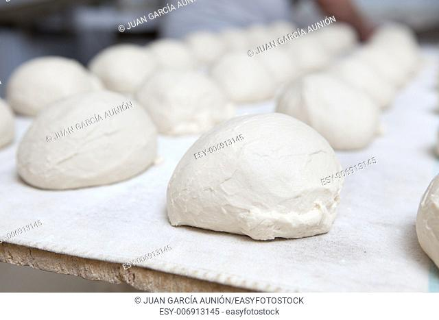 Raw pieces of bread dough before fermentation. Manufacturing process of spanish bread