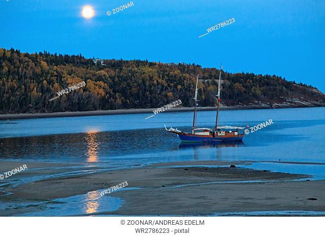 Sailing boat in the moonlight