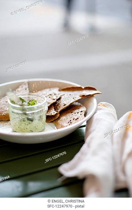 Fresh cheese with crispbread (close up)