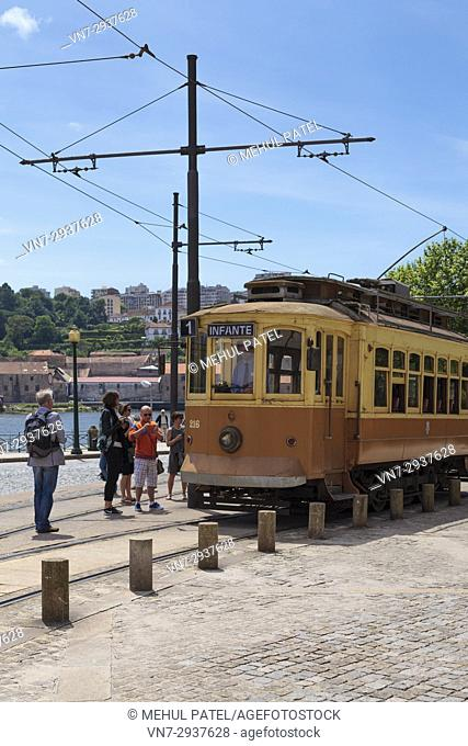 Vintage electric tramcar in Porto, Portugal. Three tramcar lines now remain in Porto with Line 1 from Infante to Passeio Alegre popular with tourists as it...