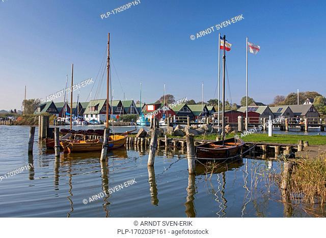Sailing boats and boathouses at the harbour of Althagen at Fischland-Darß-Zingst, Mecklenburg-Vorpommern, Germany