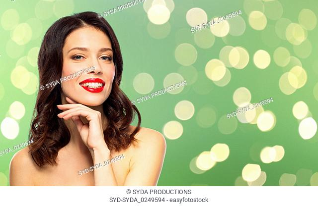 beautiful smiling young woman with red lipstick