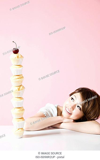 Woman looking at stack of cakes