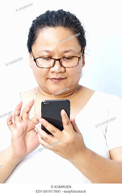 Young Asian woman texting on cellphone, using smart phone update her lifestyle on social media, human behavior concept