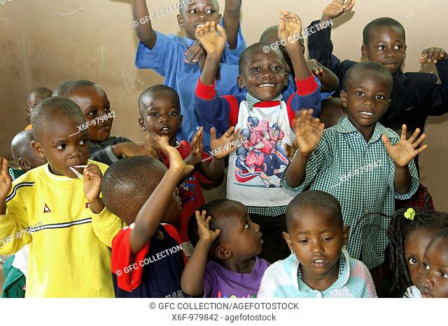 Rackety pre-school children in a simple day care centre in Akropong-Akwapim, Eastern Region, Ghana