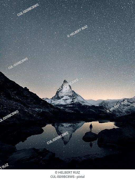 Matterhorn reflecting over Lake Riffelsee at night, Zermatt, Valais, Switzerland