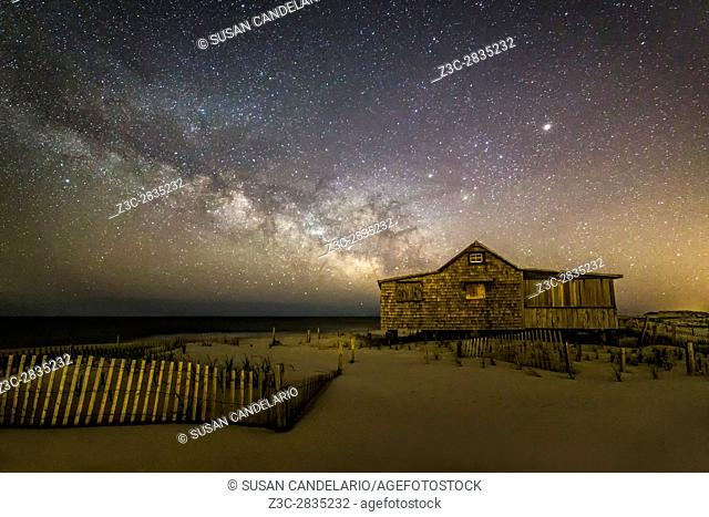 NJ Shore Starry Skies and Milky Way - Island Beach State Park at the NJ Shore with beach fences leading to the Judge's Shack underneath a starry sky with the...