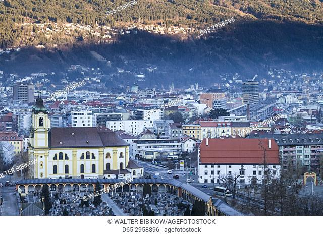 Austria, Tyrol, Innsbruck, elevated view of the Wilten Basilica, dawn, winter