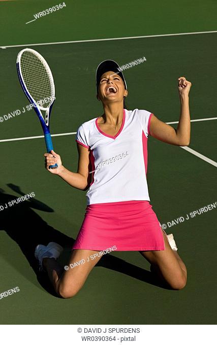 Tennis player celebrates winning tennis match