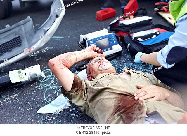 Car accident victim laying in road