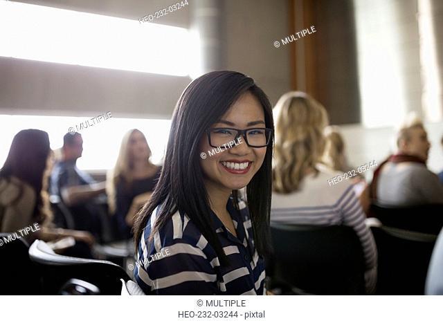 Portrait enthusiastic student smiling in auditorium audience