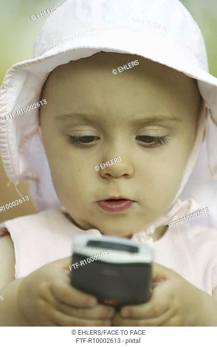 Little girl using a mobil phone