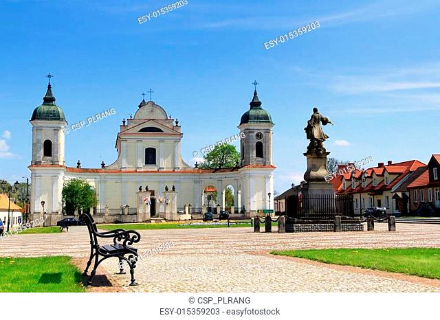 Town square in Tykocin, in Poland, Church of the Holy Trinity and monument to hetman Stefan Czarniecki