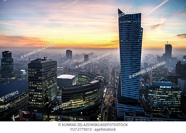 Sunset over Warsaw, Poland. Aerial view with Golden Terraces shopping mall, Zlota 44 skyscraper and Warsaw Towers