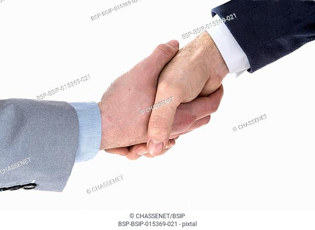 Two business men shaking hands on a white background