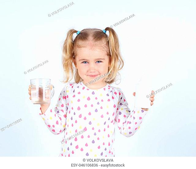 Little girl holding a filter for drinking water and a glass of clean water
