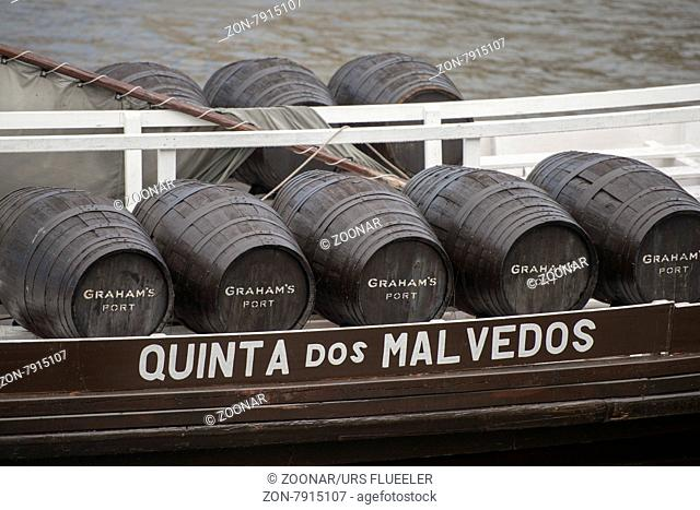 the port wine Boats at the waterfront with the old town on the Douro River in Ribeira in the city centre of Porto in Porugal in Europe