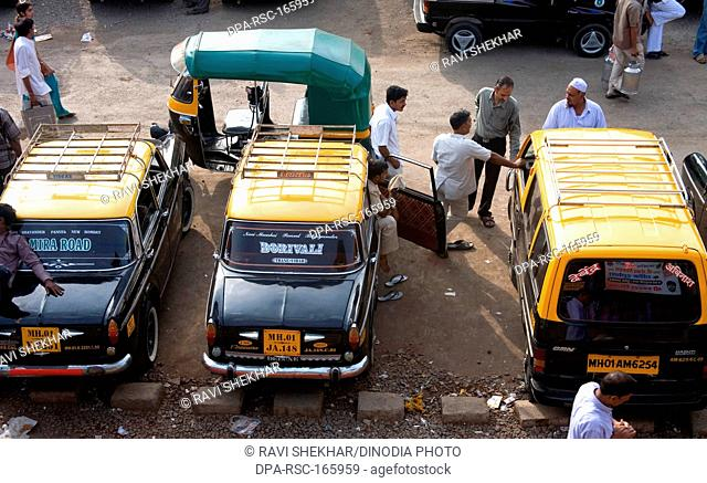 Vehicles parked outside at Borivali ; Bombay Mumbai ; Maharashtra ; India