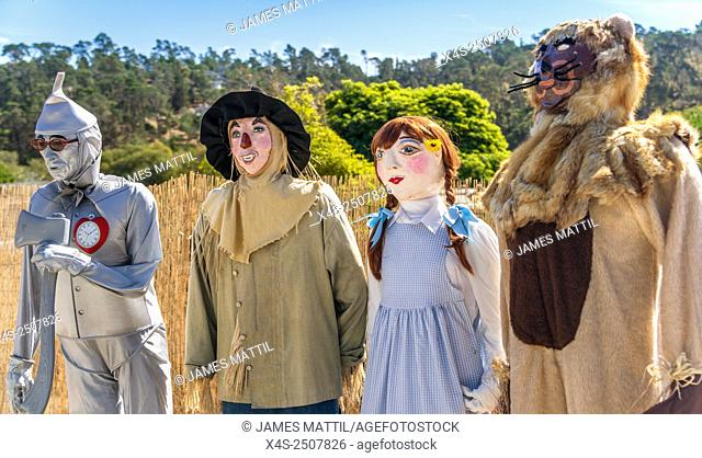 Tin man, Cowardly Lion, Dorothy and Scarecrow from The Wizard of Oz enter the scarecrow festival in Cambria, CA