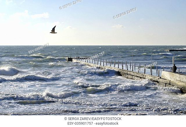Sea wave splashing against a pier in Odessa. Black Sea