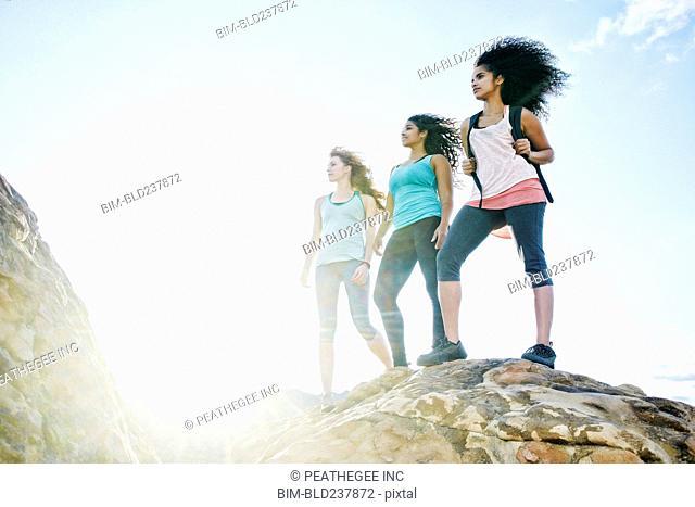 Women standing on rock