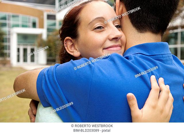 Students hugging on campus