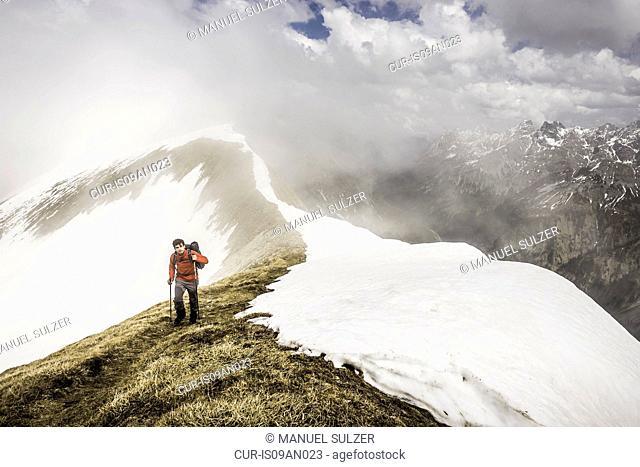 Young man mountain trekking in Bavarian Alps, Oberstdorf, Bavaria, Germany