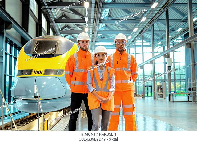 Group portrait of apprentices at railway engineering facility