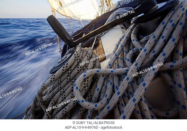 Photograph of a sail boat cruising on the Mediterranean sea