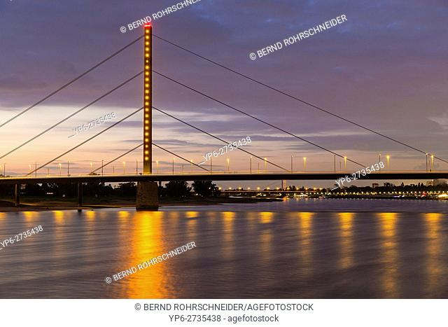 Rhine with bridge at dusk, Düsseldorf, North Rhine-Westphalia, Germany