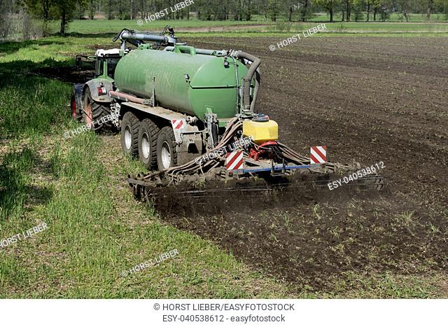 The manure is introduced into the field with a two-slice injection. Gütersloh, North Rhine-Westphalia, Germany, Europe