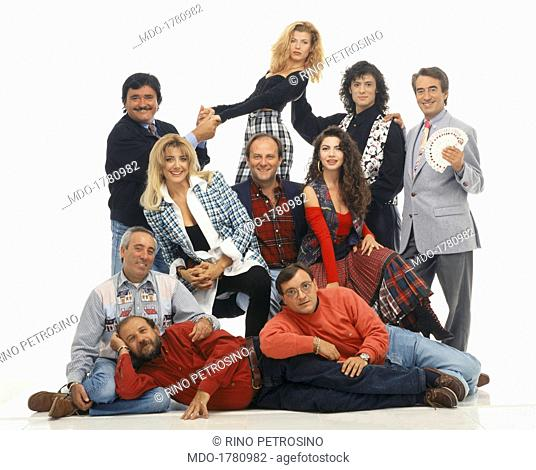 A promotional photo for the TV show Buona Domenica, with the whole cast dominated by the host Jerry Scotti, in the middle with his helpers Gabriella Carlucci...