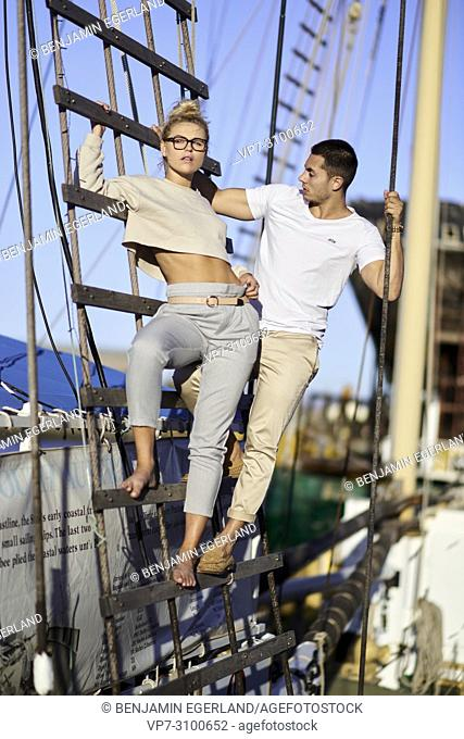 Australia, Adelaide, Fashion Bloggers Sarah Jeavons and Reno Marrasso on mast of ship, couple, travelling, wanderlust, travel lust, cool attitude, relationship