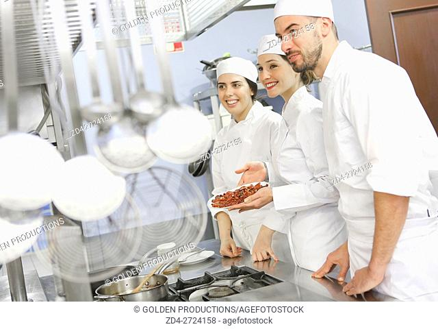 People preparing food in restaurant kitchen